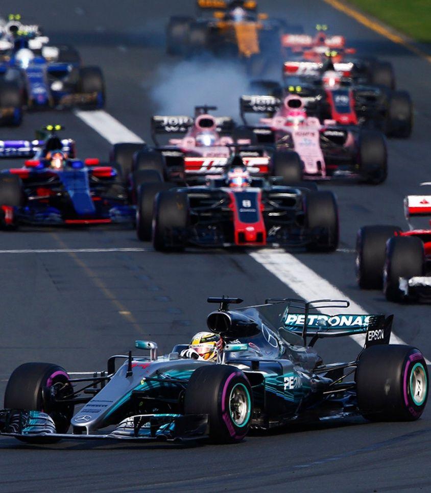Lewis Hamilton, Mercedes F1 W08 EQ Power+, leads Sebastian Vettel, Ferrari SF70H, Kimi Raikkonen, Ferrari SF70H, Felipe Massa, Williams FW40 Mercedes and the rest of the field.