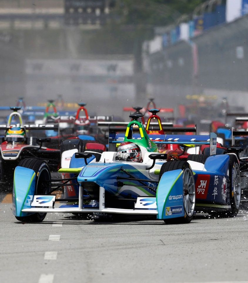 Drivers leave the starting grid during the Formula E Championship race in Putrajaya November 22, 2014. The FIA Formula E Championship is the world's first fully electric racing series. REUTERS/Olivia Harris (MALAYSIA – Tags: SPORT MOTORSPORT TPX IMAGES OF THE DAY)