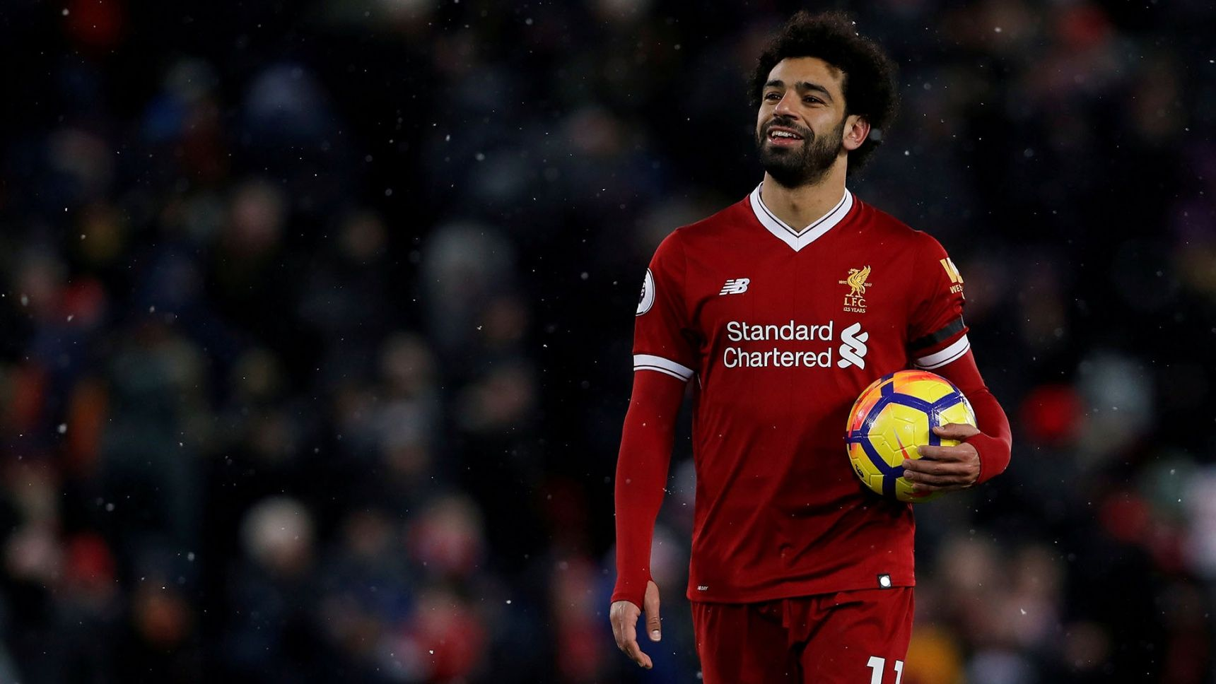 "Soccer Football – Premier League – Liverpool vs Watford – Anfield, Liverpool, Britain – March 17, 2018   Liverpool's Mohamed Salah celebrates with the match ball after the match    Action Images via Reuters/Lee Smith    EDITORIAL USE ONLY. No use with unauthorized audio, video, data, fixture lists, club/league logos or ""live"" services. Online in-match use limited to 75 images, no video emulation. No use in betting, games or single club/league/player publications.  Please contact your account representative for further details.     TPX IMAGES OF THE DAY"