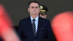 Bolsonaro criticó a Fernández e insultó a un periodista